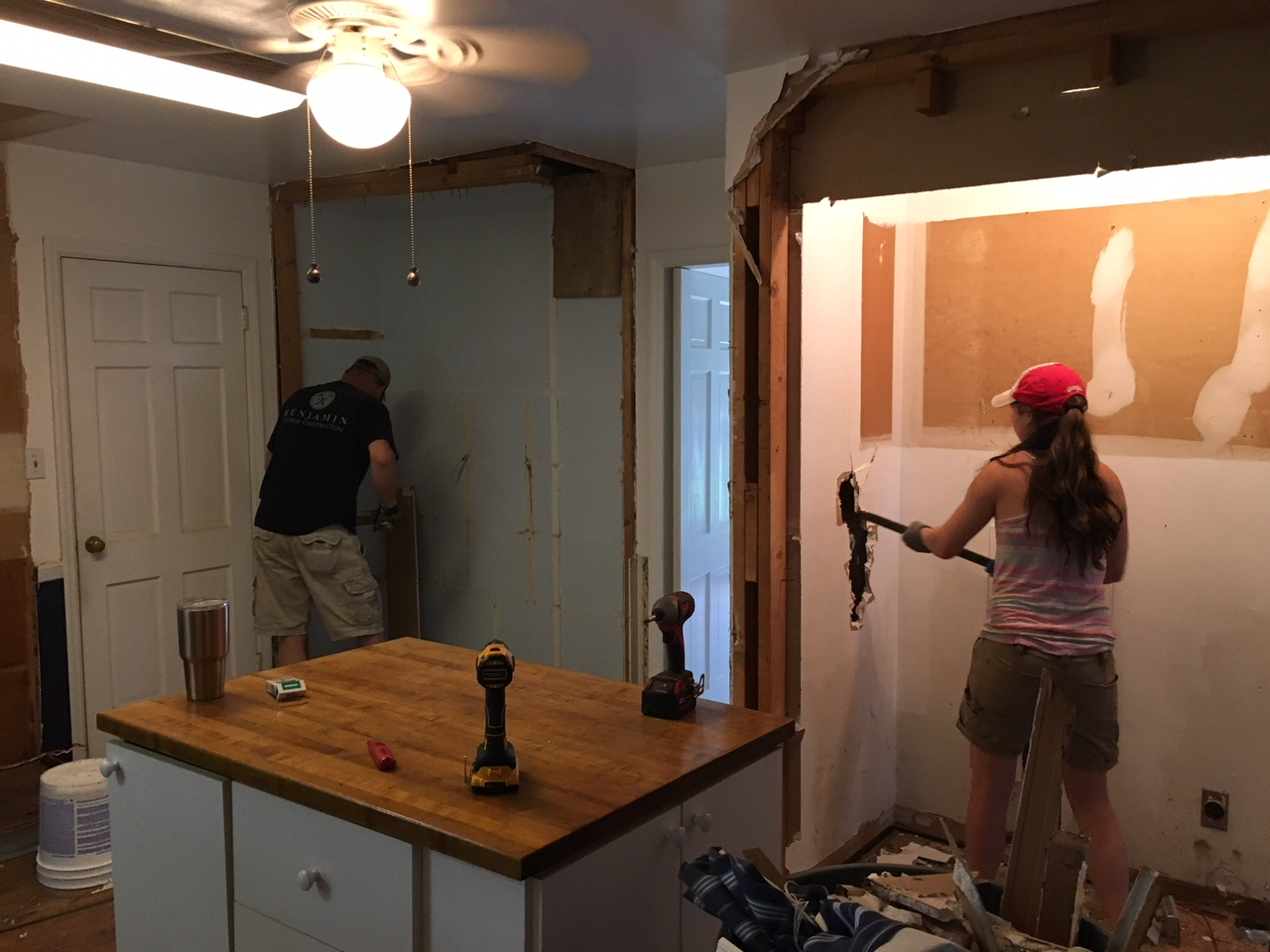 Brad & Hannah demo-ing the kitchen at the Smith project.