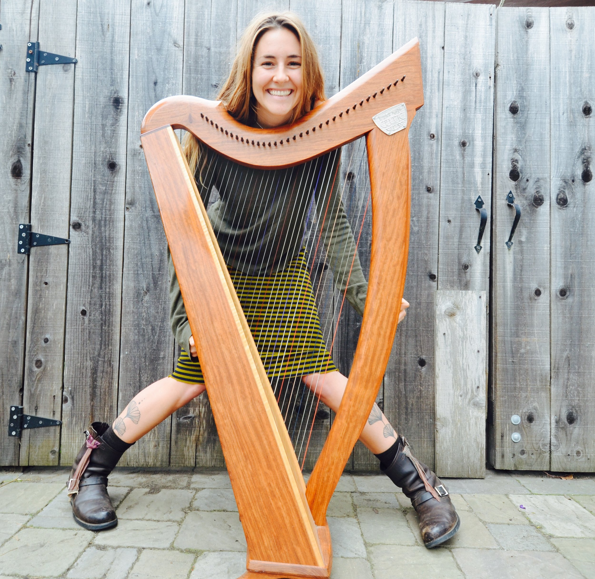 Ella Dawn Jenkins: After 4 years studying traditional Scottish music and the Gaelic language in Glasgow Scotland, Ella Dawn Jenkins is a Bay Area based harpist and songwriter of blues, folk and pop influence. (photo: green dress)