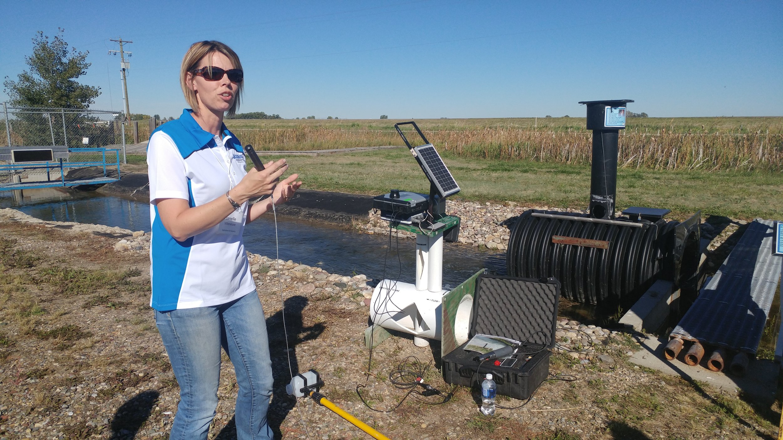Janelle Villeneuve, Water Quality Specialist, Alberta Agriculture and Forestry giving a presentation of the equipment her team used on the synoptic surveys of the Oldman and the Bow Rivers.