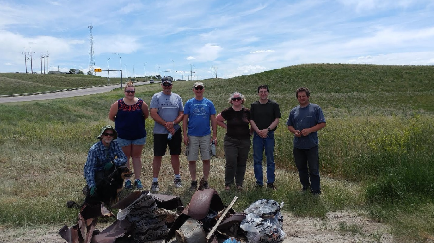 Volunteers with garbage collected in the coulees.