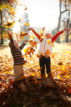 42498-Kids-Playing-In-Leaves.jpg