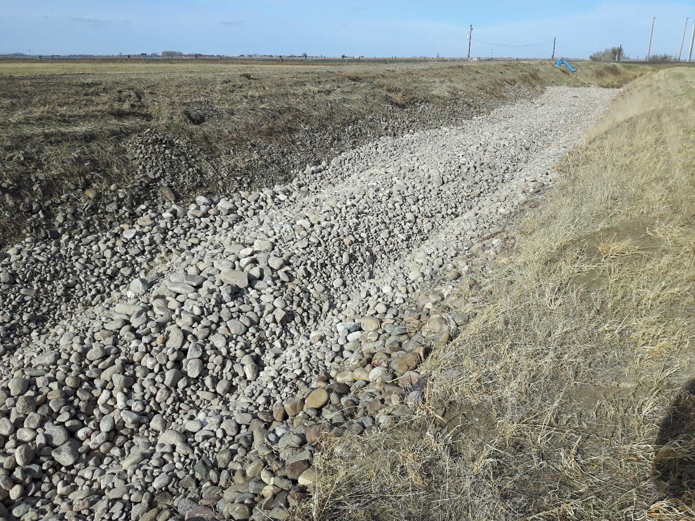 TID Infiltration Weir: Completed Windrow Looking Downstream