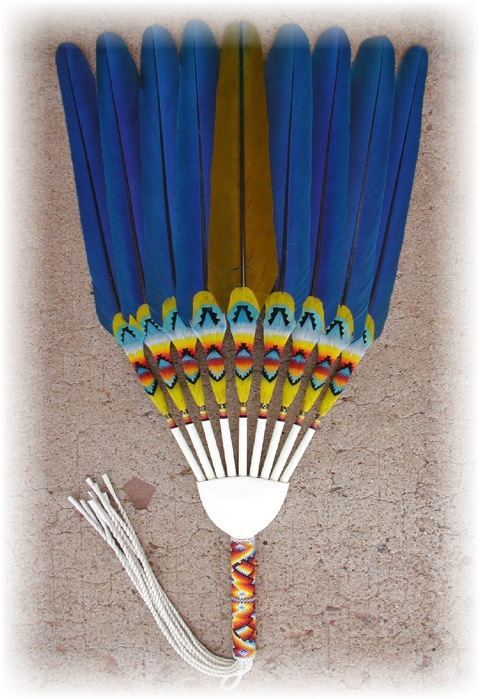 This is a Stiff Flat Fan, INDIVIDUAL. The big difference on this one is that each individual feather is feather worked. The feathers in this fan does one move, they are permanently set, it is a stiff fan. This type of fan would be used by dancers, or by ladies in the peyote ceremonies. Many traditional dancers (common among both men and ladies) and jingle dancers like this style fan. Usually a bigger fan box is needed for this type of fan. Some people prefer straight cut fringes on these types of fans. Most NAC people prefer twisted leather fringes on these types of fans.