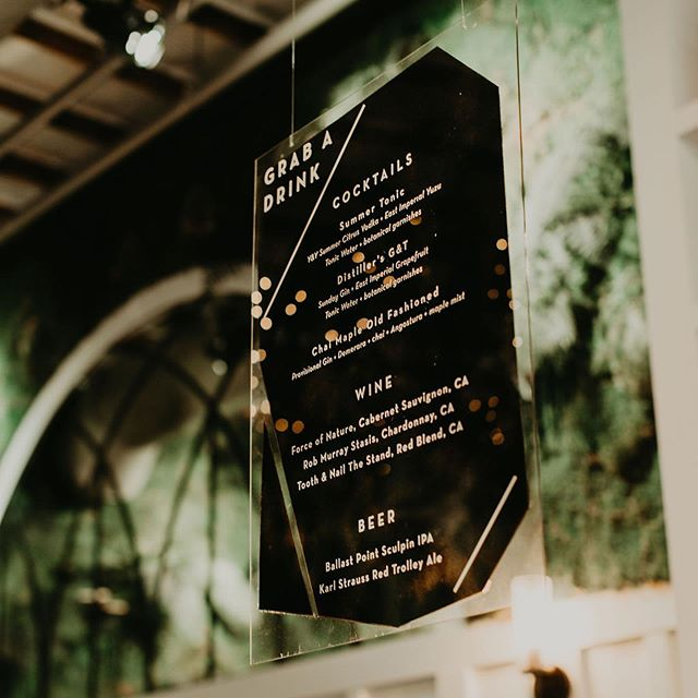 Minimal geometric look for the bar menu. White vinyl lettering placed on the front of a piece of clear acrylic with black painted on the back. ☲☲☲☲☲☲☲☲☲☲☲☲ Venue: @florathevenue  Photography: @nelly_cabanillas  Florals: Corie & Jordan @florathevenue  Coordination: Corie & Jordan @florathevenue  Tableware: @hostesshaven  Calligraphy & Signage: @pearlandpen  Ceremony Backdrop: @pearlandpen Cake: @dlitefulchocolat  Dress Designer: @watters  Bridal Boutique: @bridal_showcase  Models: Alain & Alyssa of @amardiamonds  Jewelry: @amardiamonds  Videography: @vitallightfilms Beverage: @youandyourssd . . . . #pearlandpen #sandiegowedding #modernwedding #weddinginspiration #sandiegoevents #inspiredbythis #sandiegobride #socalbride #eventsignage #weddinginspiration #weddingbackdrop #decor #textureart #artbackdrop #sandiegowedding #bohowedding #weddinginspiration #sandiegoevents #inspiredbythis #sandiegobride #