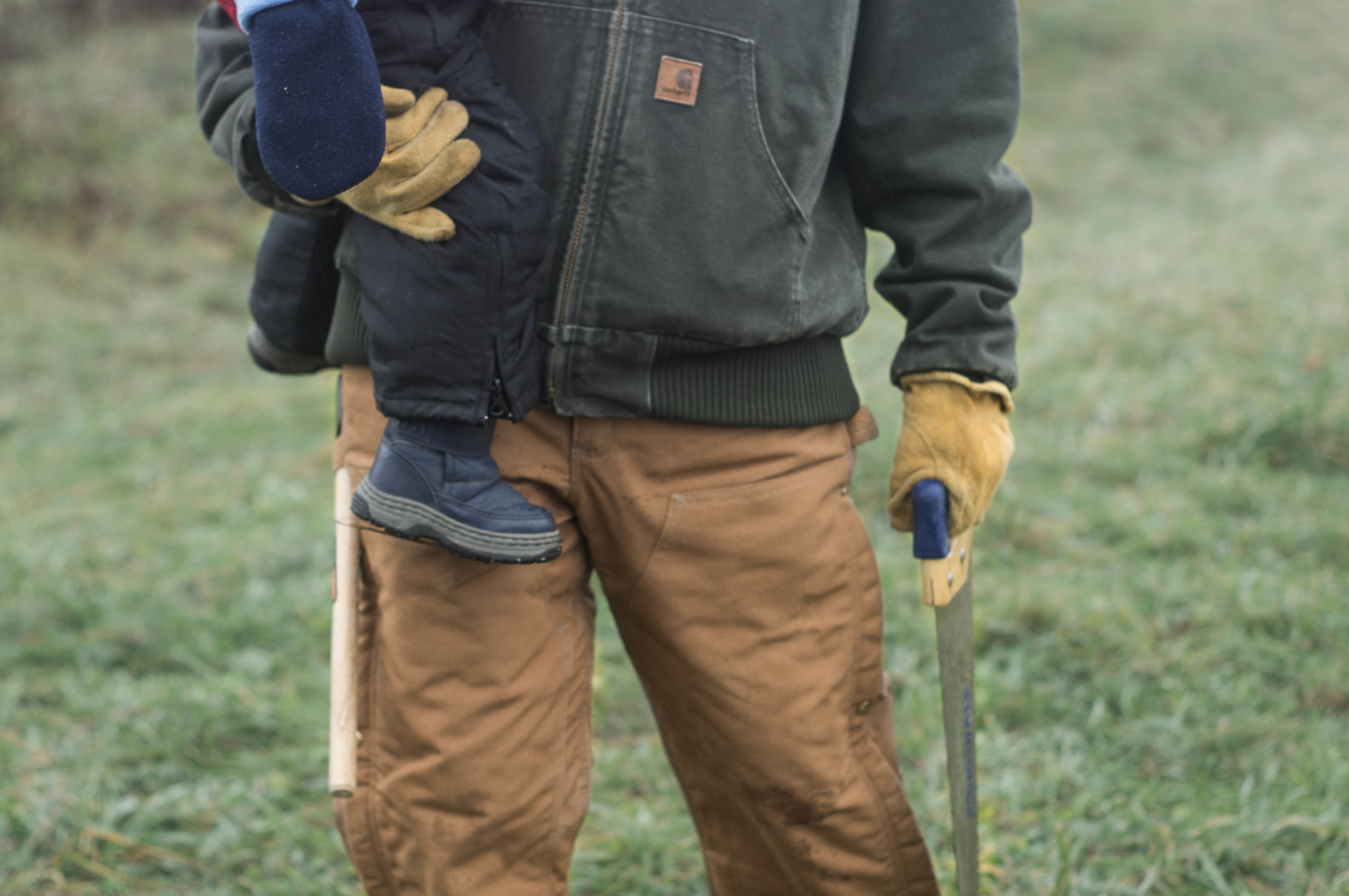 brother-holding-baby-with-hatchet
