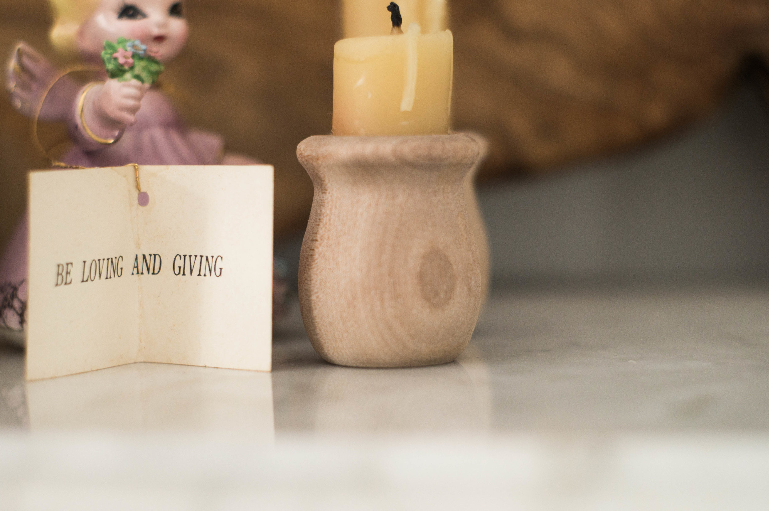 vintage antique angel doll and beeswax candles by samantha spigos