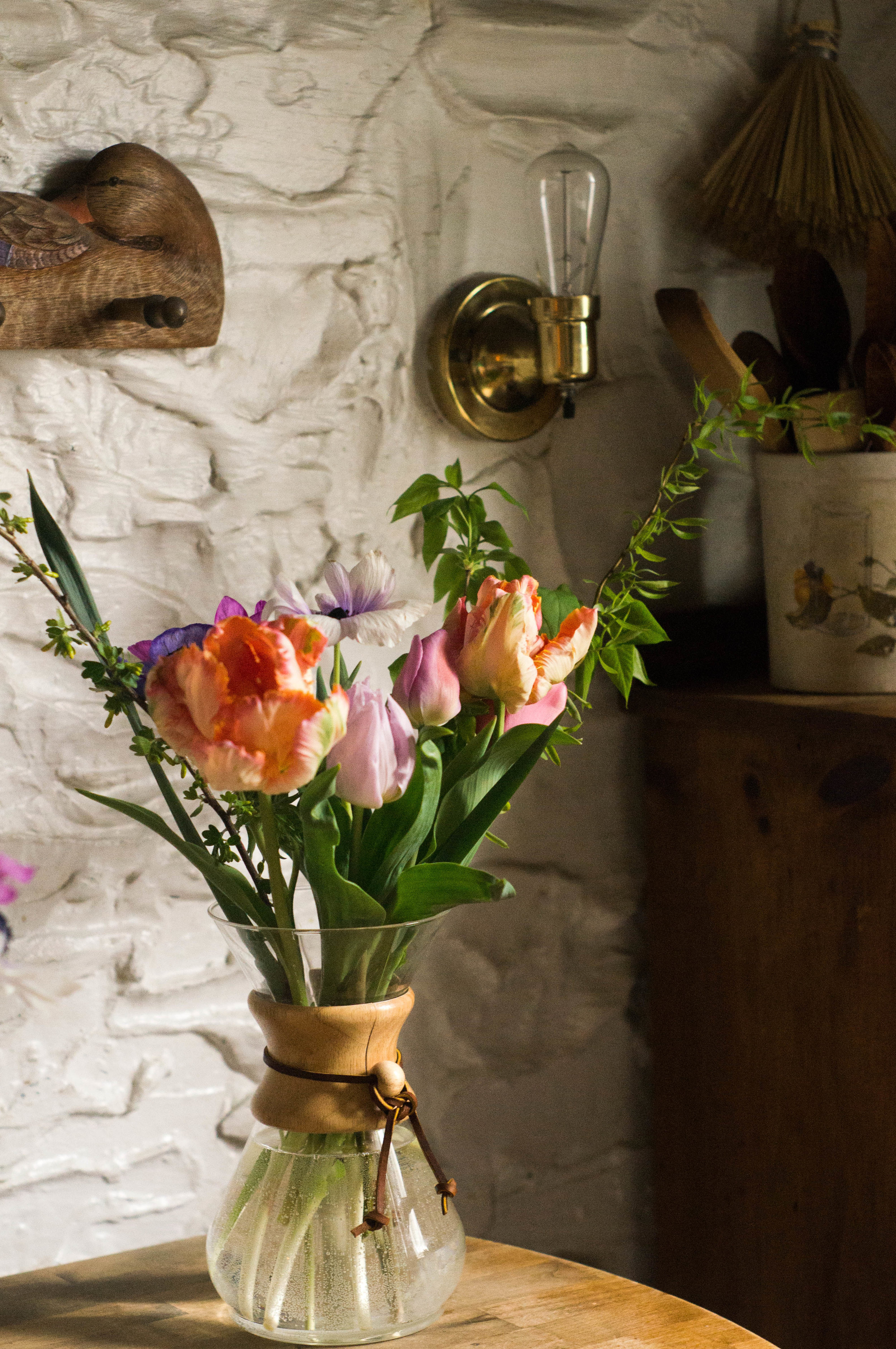 farm fresh tulips and anemones in a vase by samantha spigos