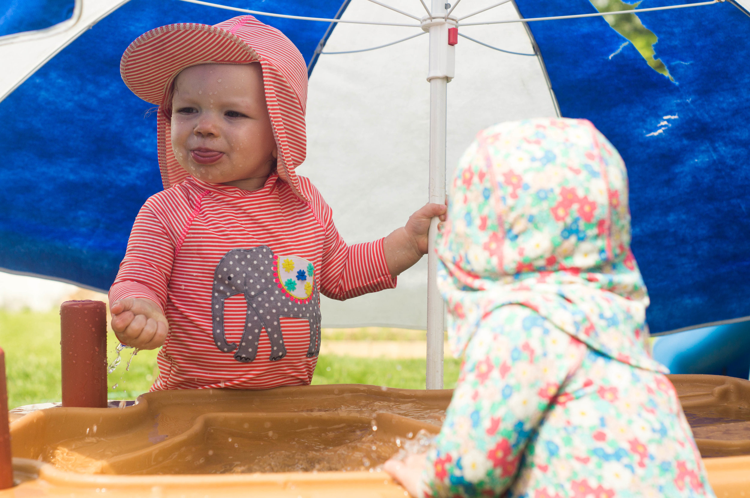 babies at a water table by samantha spigos