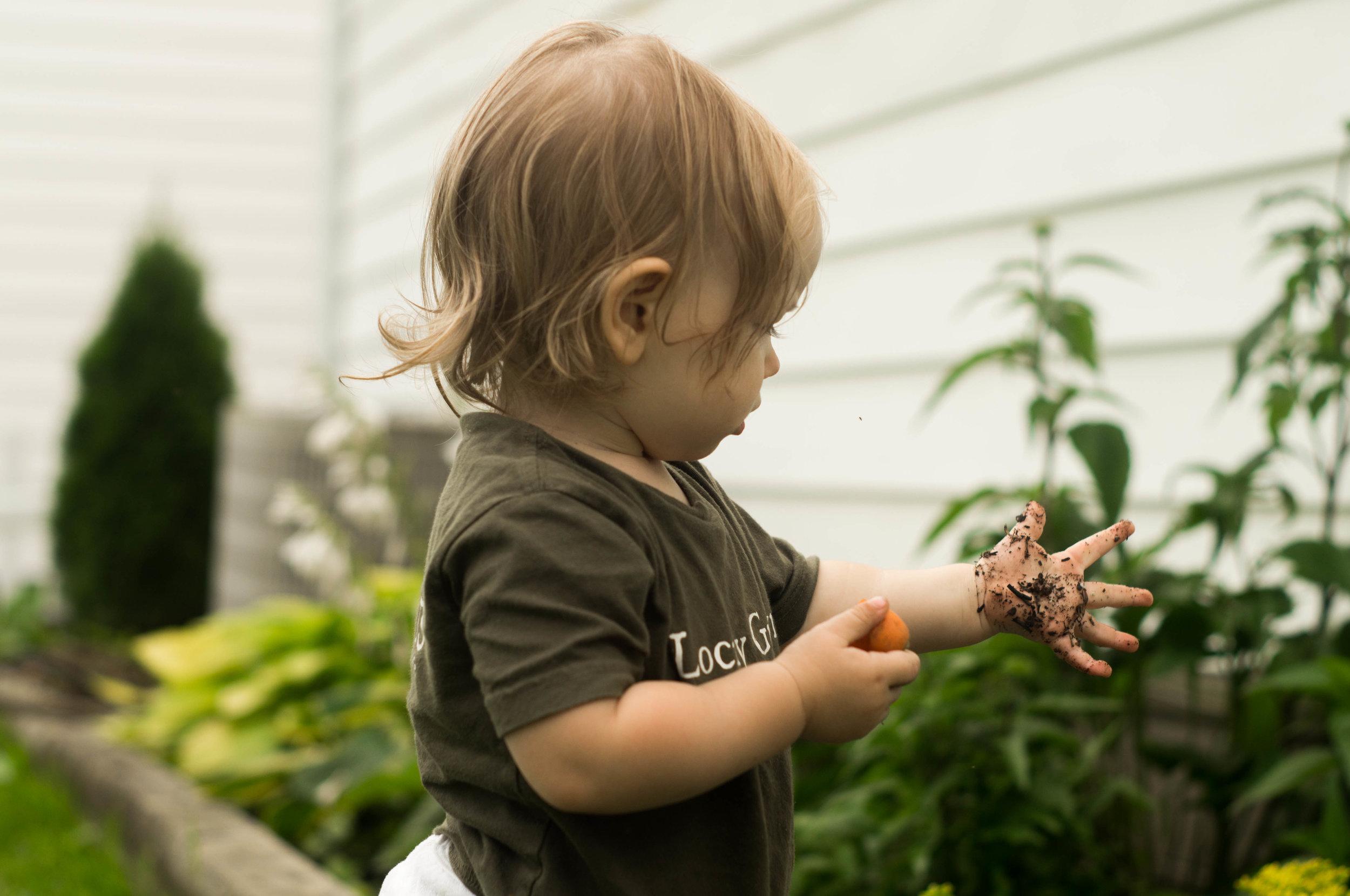 daughter in a garden by samantha spigos