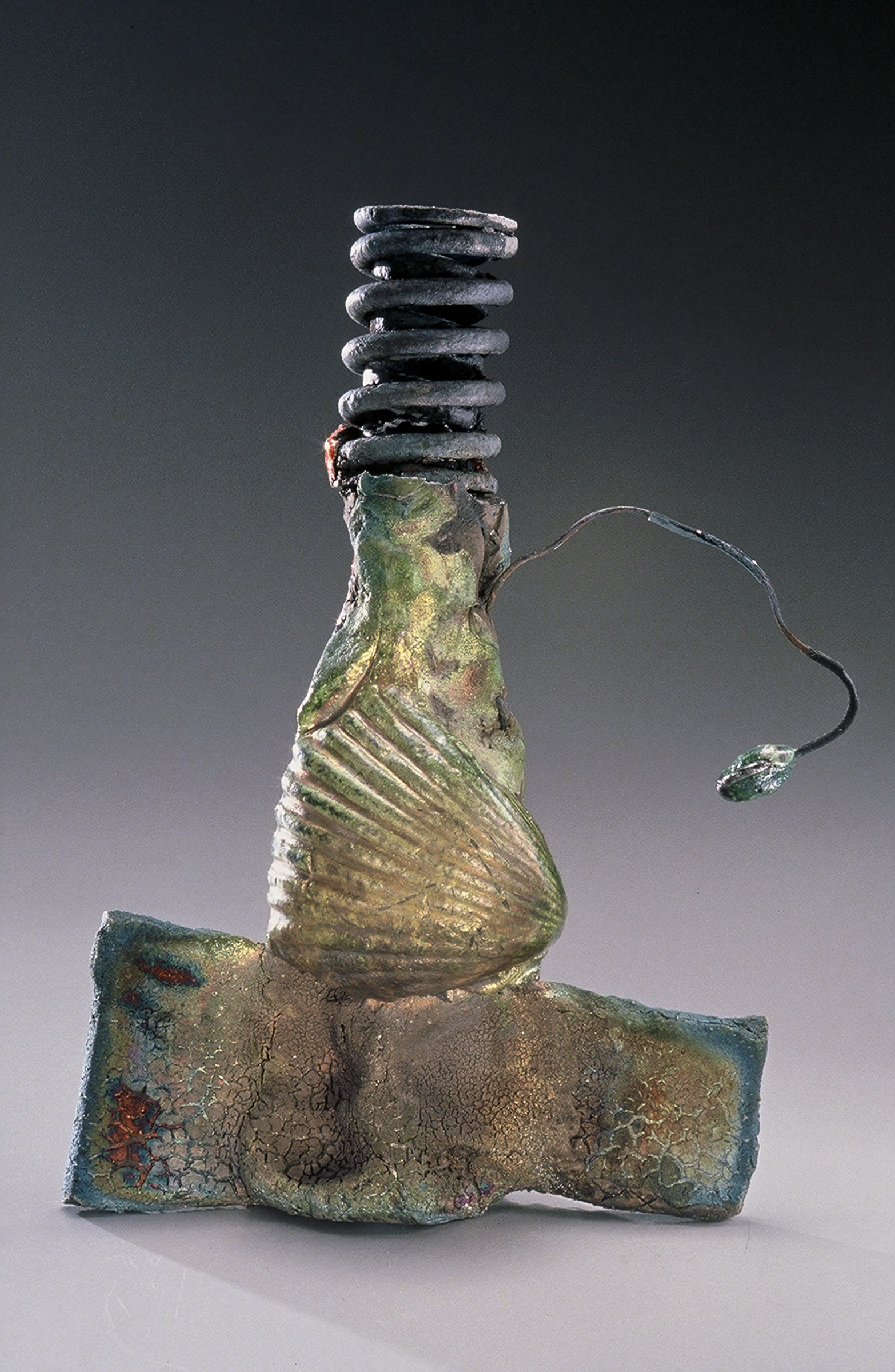 """THE FISHERMAN     Raku-fired metal and clay  2000. 15"""" H x 4"""" diameter. In a private collection"""