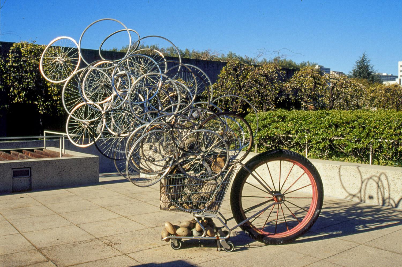 CARTWHEELS . 2002-2010 Oakland Museum of CA., Sculpture Garden. Multiple exhibitions including Napa Valley Museum 2011. Salvaged  shopping cart, bike wheels, large farm cart wheel, river rocks.