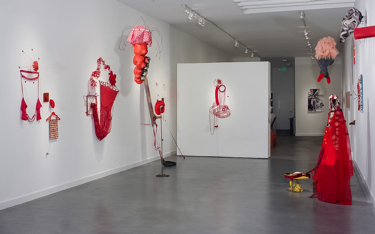 """""""Red in the Interlude""""   fabric, found objects, thread, wire"""