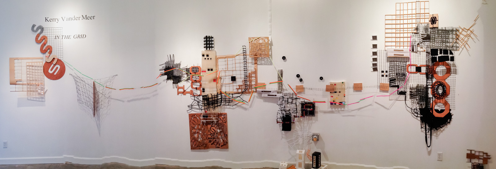 """""""In the Grid""""  Found objects, wood, fabric, wire, straws, paper, plastic"""