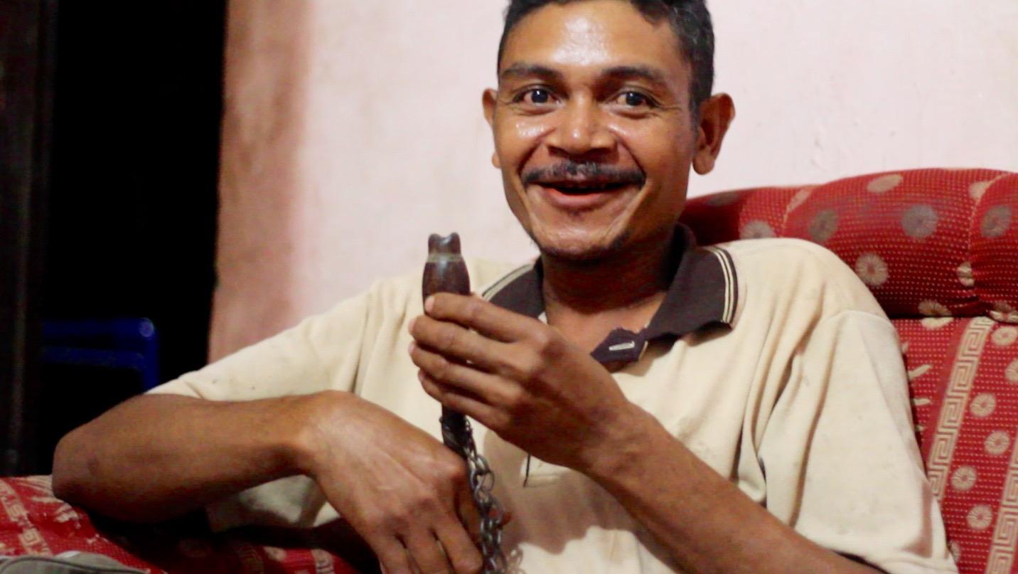 Pak Yoseph shows off his cow-calling feku in Babotin