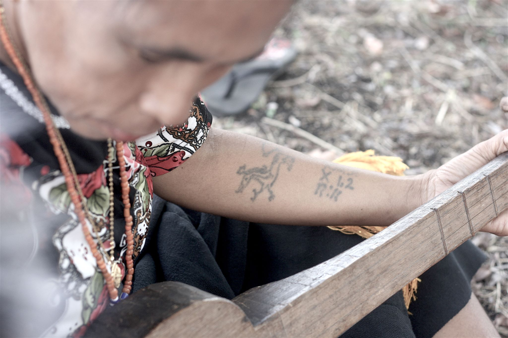 Like many men and women of her generation, Ata Ratu has traditional tattoos depicting  marapu  spirits and mysterious numbers and letters. Photo by Joseph Lamont.