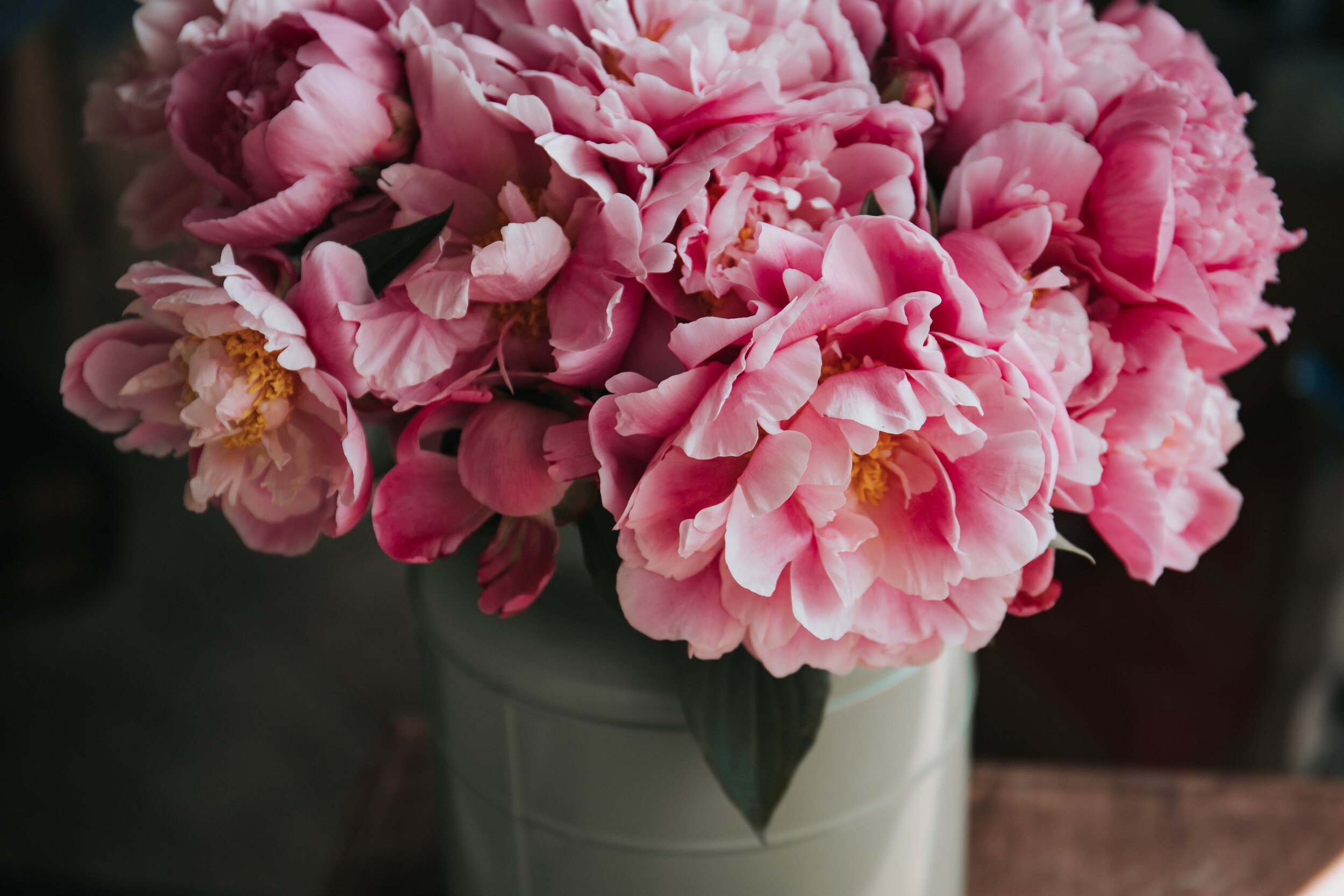 Shades of pink with dark greys and gold