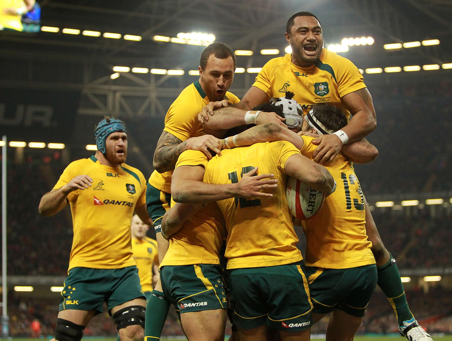 Australian players celebrate a try