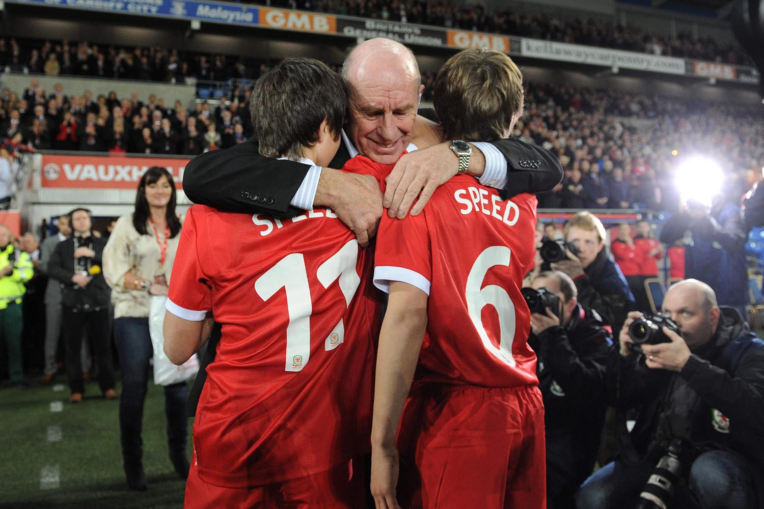 Gary Speed's father Roger hugs his grandsons Ed and Tommy