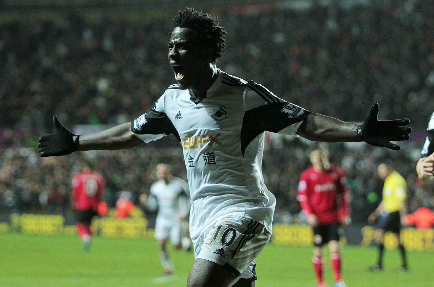 Wilfried Bony of Swansea City celebrates scoring