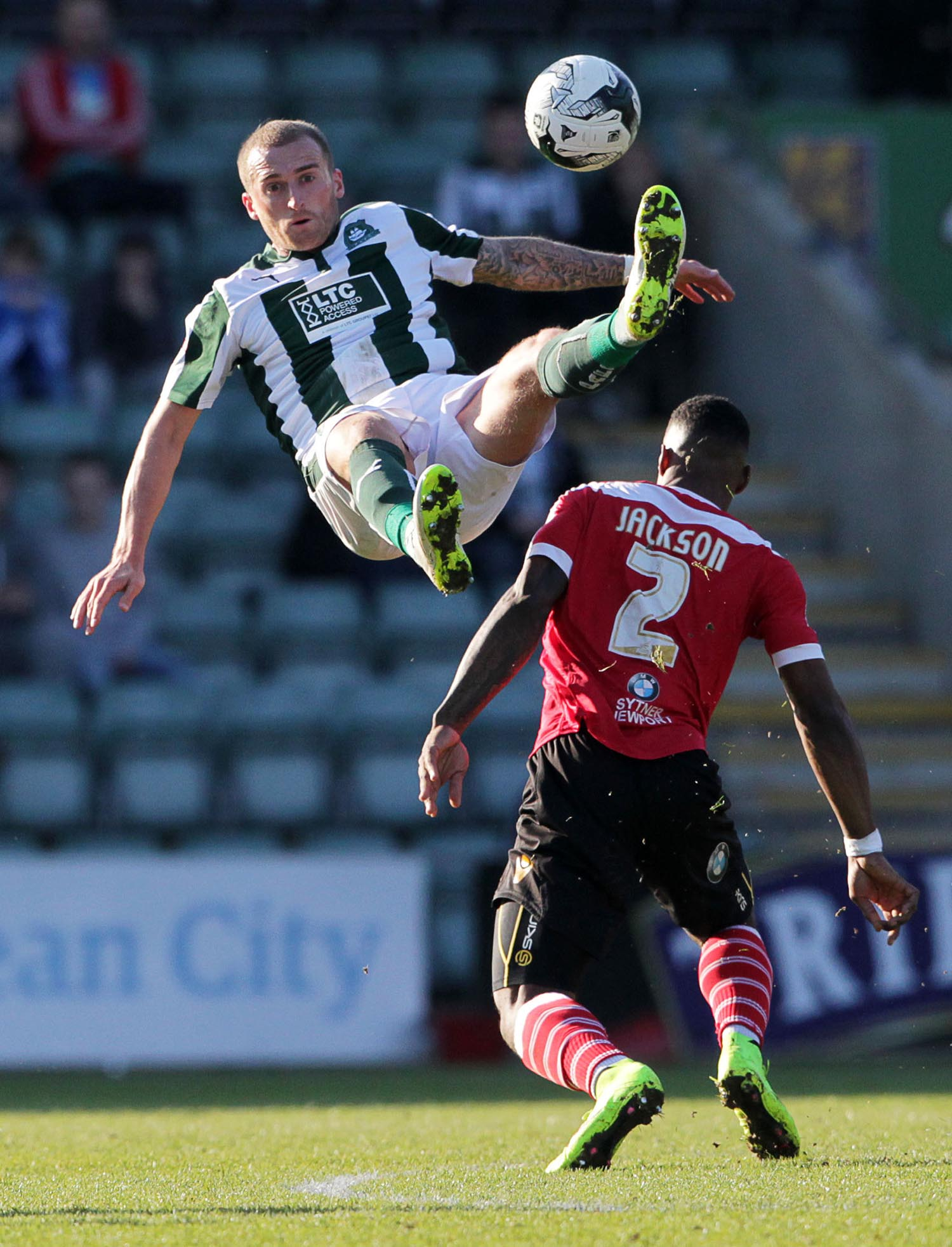 Lewis Alessandra of Plymouth Argyle flies over the head of Ryan Jackson of Newport County