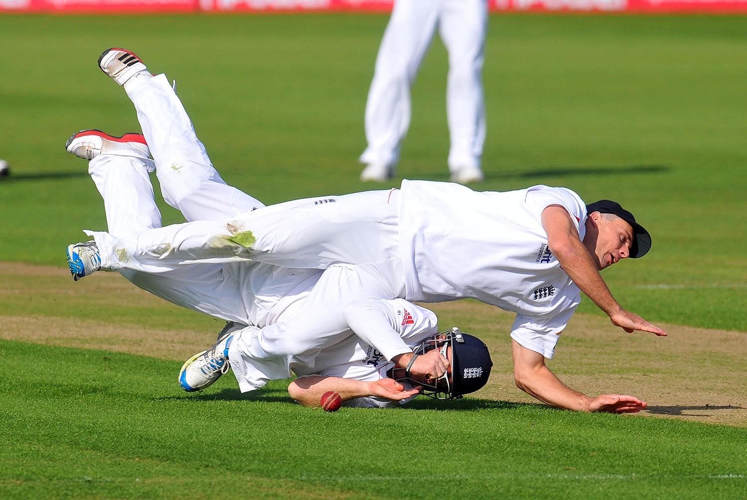 England's Ian Bell and Stuart Walters take a tumble