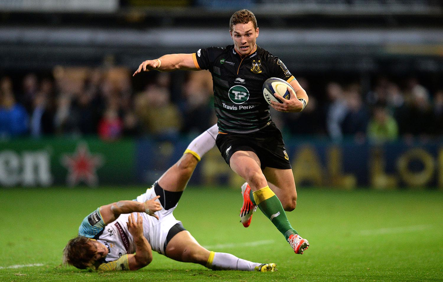 George North of Northampton is tackled by Jeff Hassler of Ospreys
