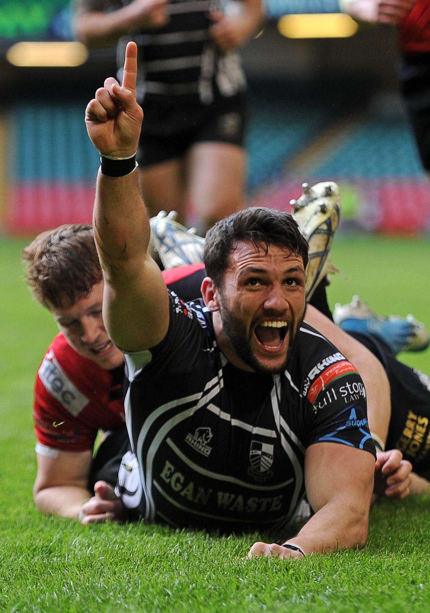 Gavin Dacey of Pontypridd celebrates scoring a try