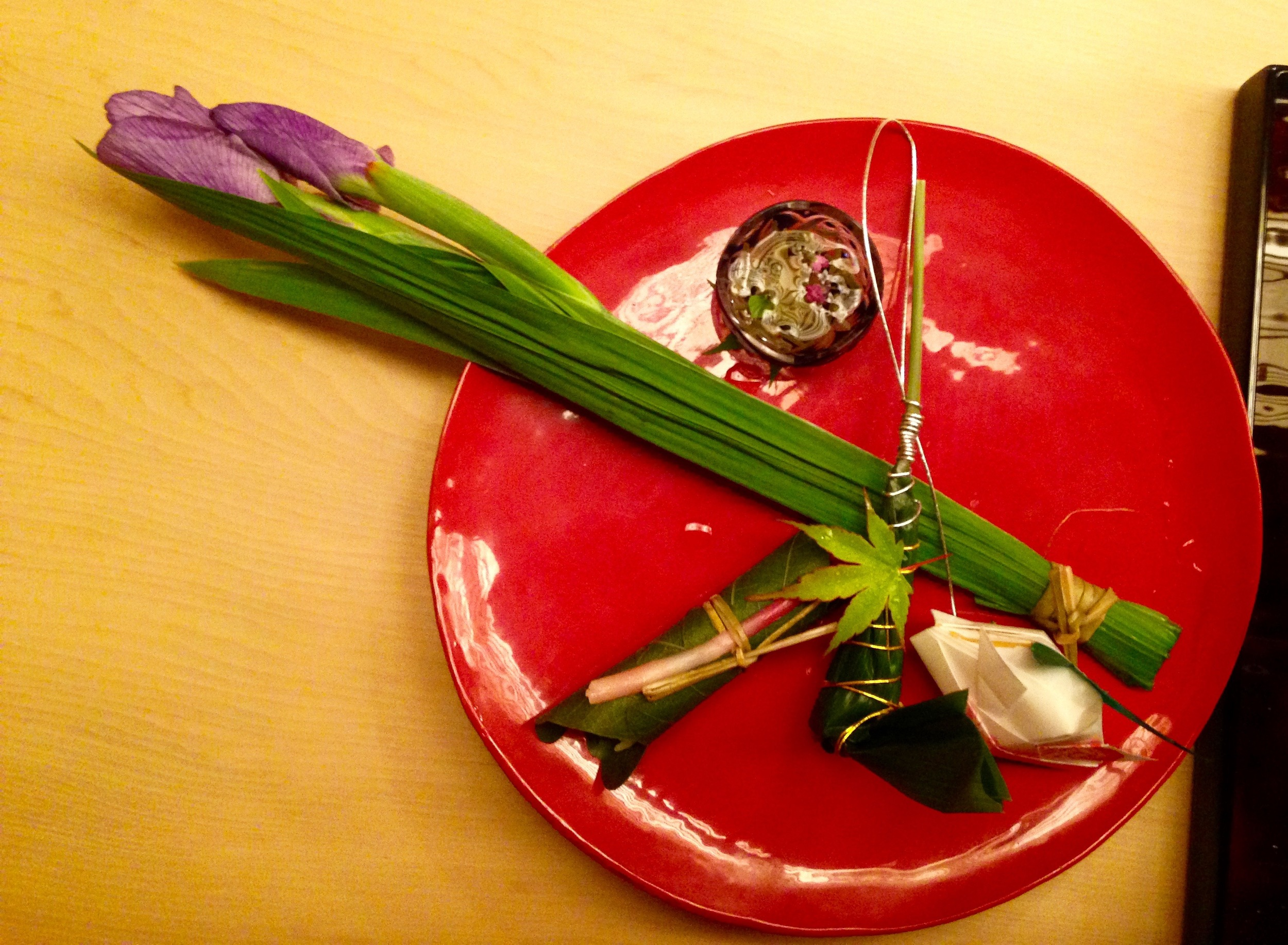 "Satsuki Course: Sea bream and conger sushi wrapped in bamboo leaves, taro & vinegar water with ""hojiso"" or perilla buds."