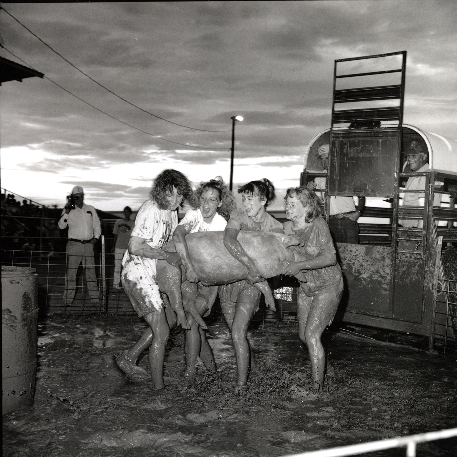 Girls with Muddy Pig, Wheatland, Wyoming, archival pigment print,16x20, 1989