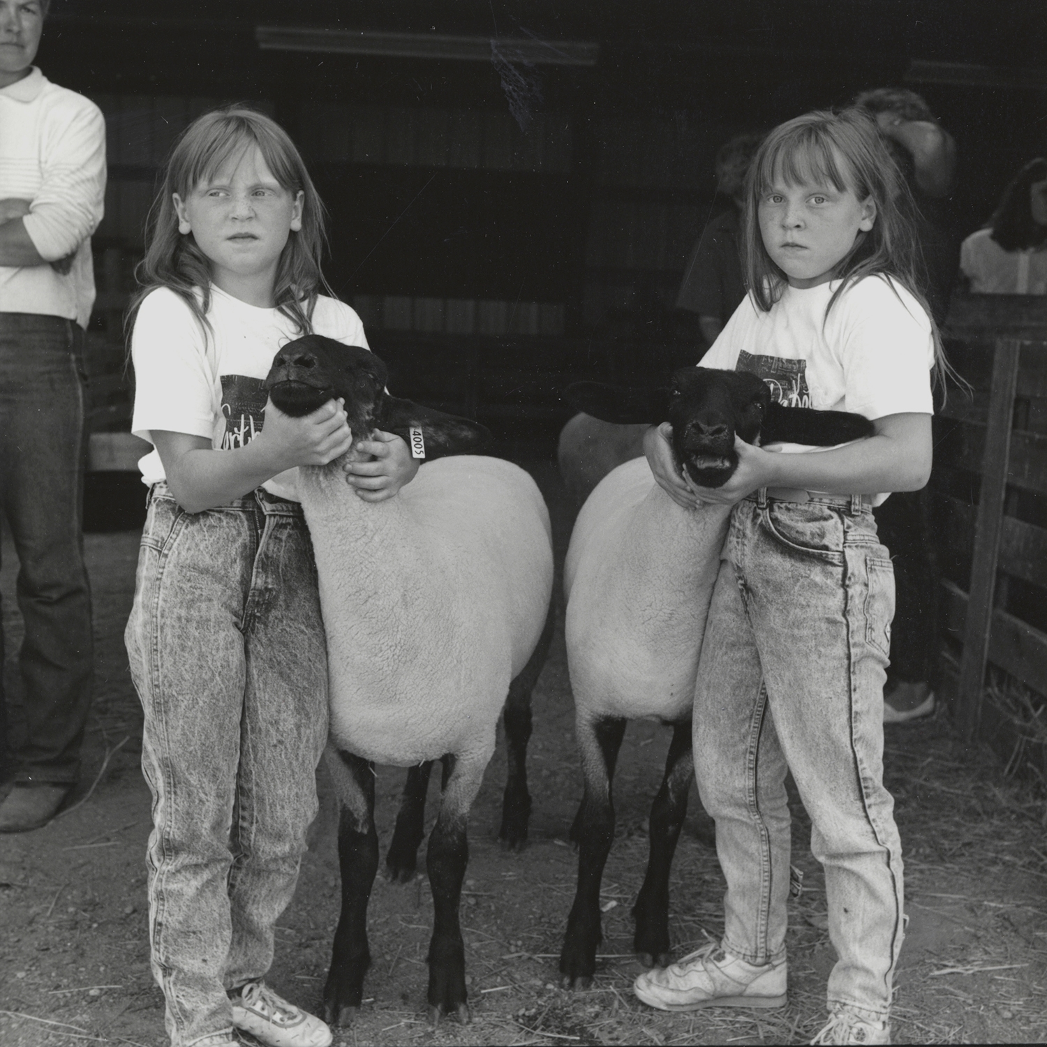 Twins with Sheep, Cooperstown, North Dakota, archival pigment print,16x20, 1989