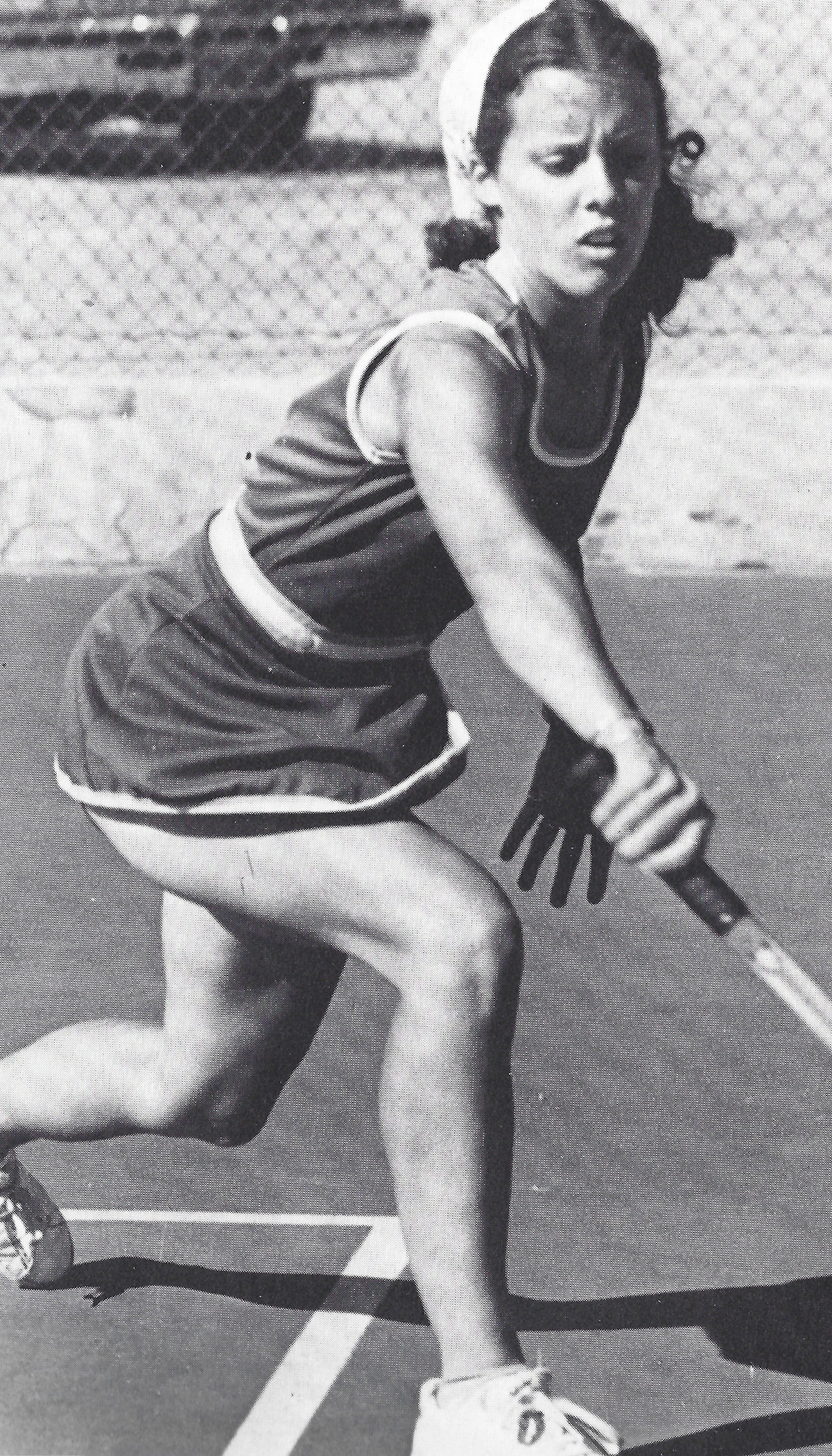 """Linda uses a backhand as she tries to stop her opponent from scoring the last winning point."" Eisenhower High Aquila 1977"