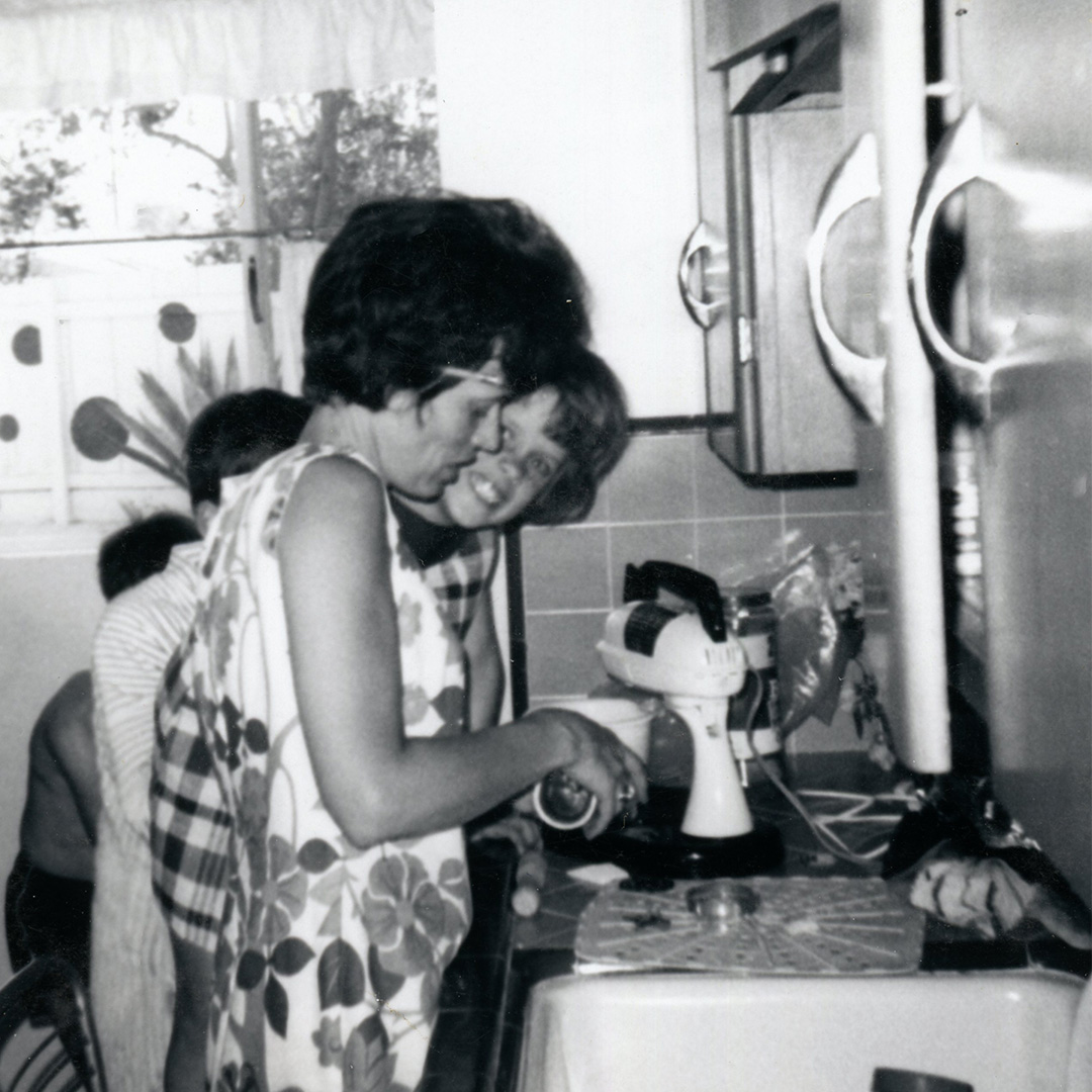 My mom and me in the kitchen