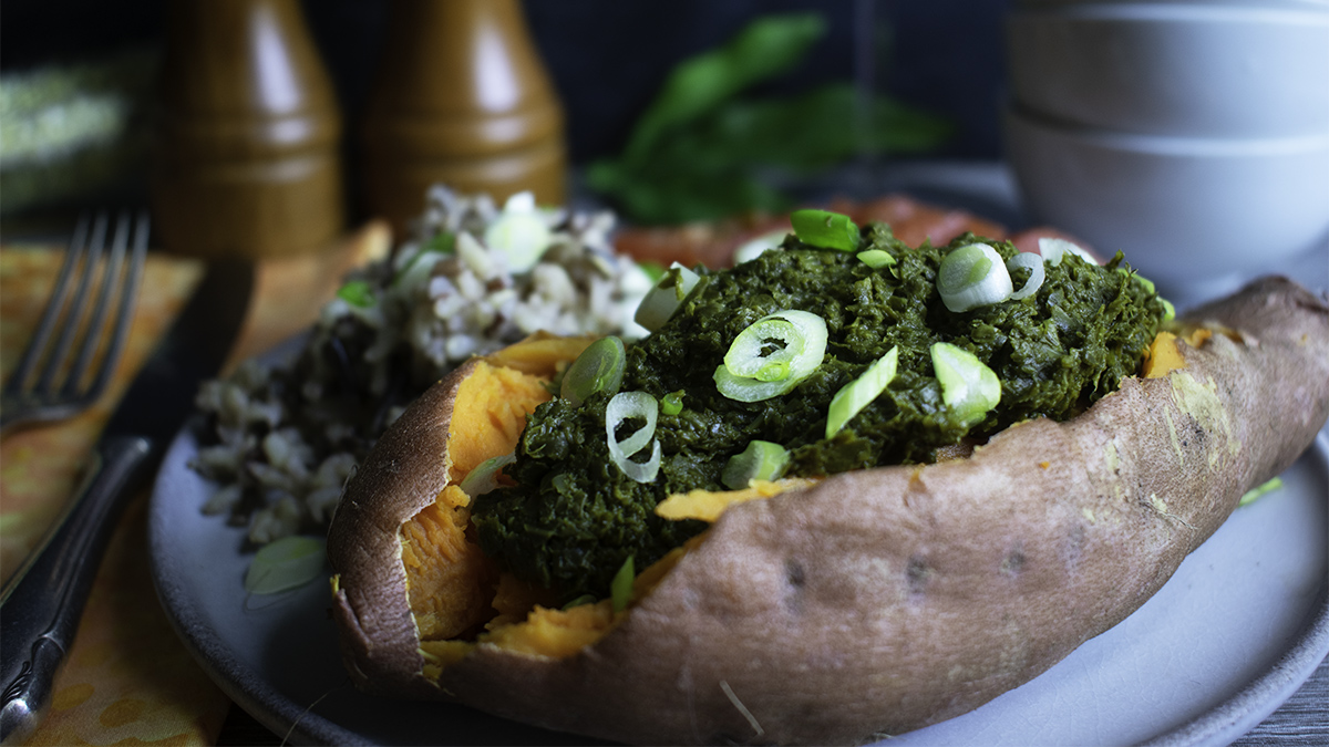 Creamy Collard Greens Puree in a baked sweet potato