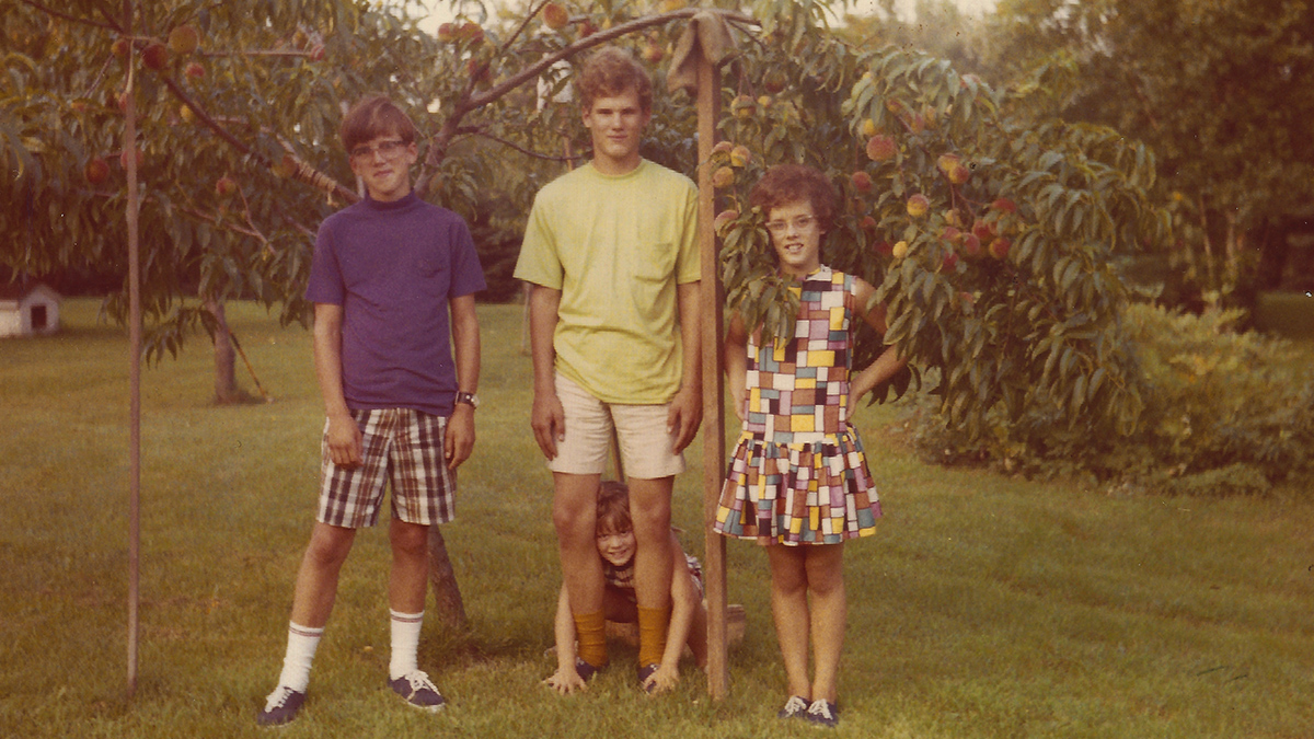 Me with my brothers and sister in a peach orchard near Ann Arbor