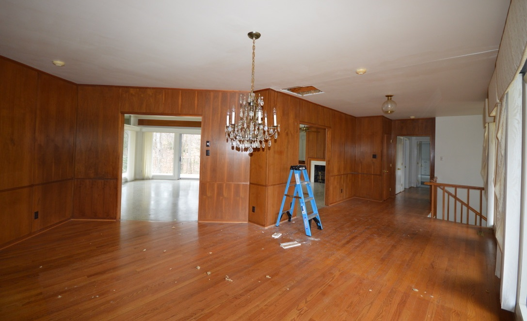 This entry and dining space will be opened up to the living room and given a face lift along with new flooring.