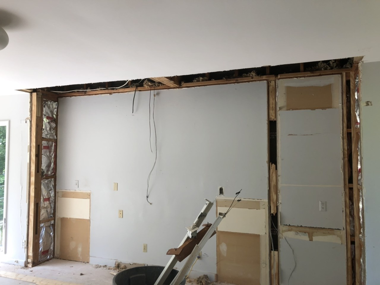 The builtin cabinets in the master bedroom have been removed. The wall will have cleaner lines when complete.