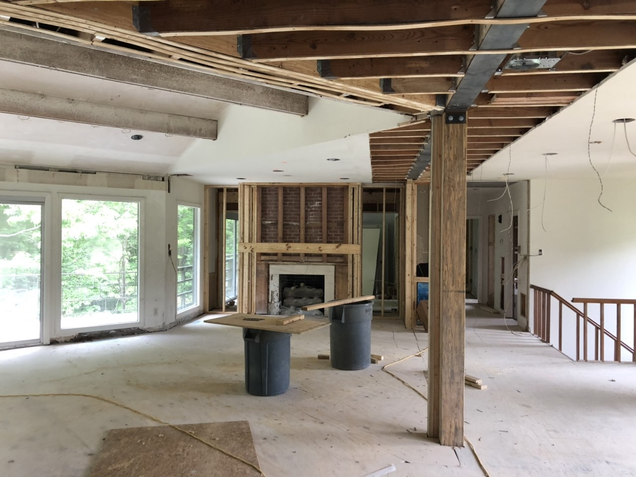 The new open living space will get new flooring and the fireplace will get a facelift.
