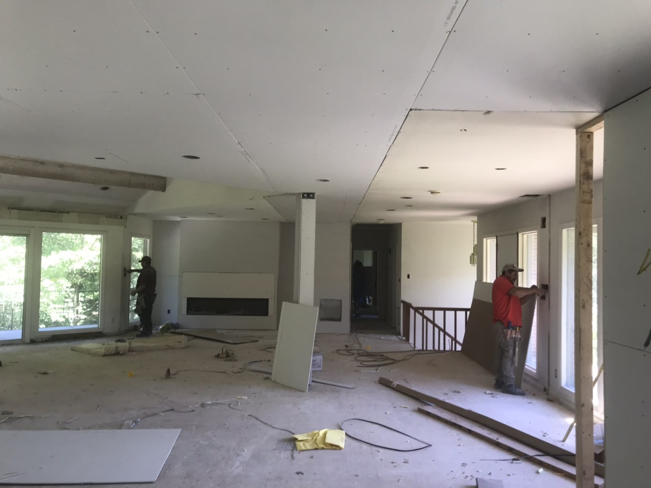 Hardwood flooring is going down and sheetrock is going up throughout the house.