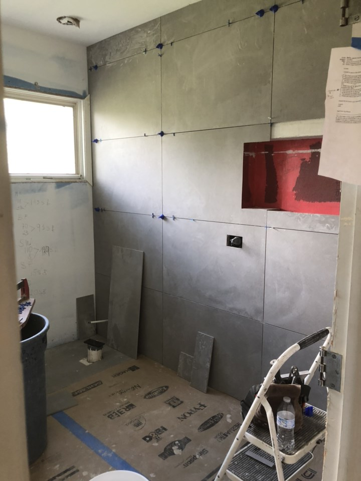 Meanwhile tile is being installed in the bath rooms. Here is a view of the master shower.