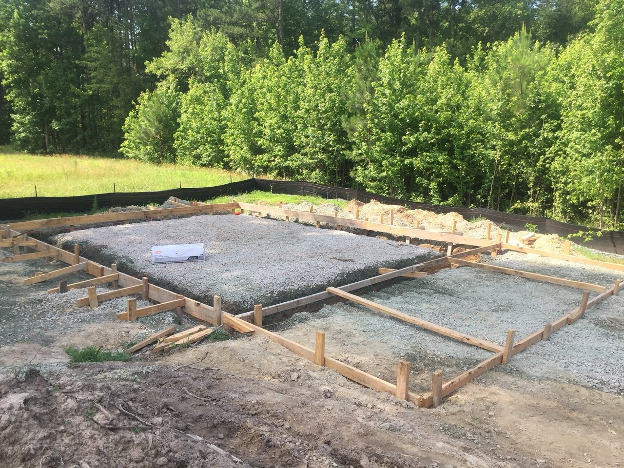 The foundation is laid for a much needed on-site storage building.