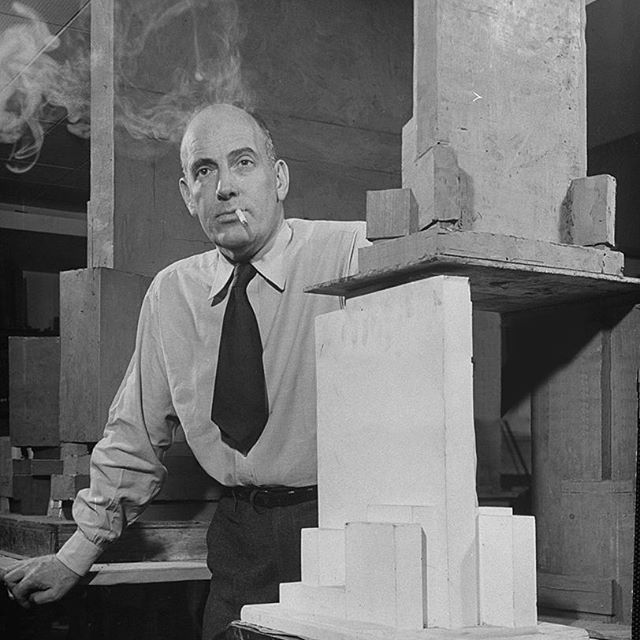 @talbotandyoon likes pictures of (overly) serious people standing next to little buildings. This is a photograph of Wallace K. Harrison standing next to models of Rockefeller Center. If you look back at these old massing studies you will find that many are made from clay and plaster, this lends them a weight and gravitas that you don't really see with today's foam and paper methods. If you didn't already notice, a big-little Rockefeller model is on the table that his hand is resting on!⠀⠀ ⠀⠀ The photograph is by Frank Scherschel for The LIFE Picture Collection/Getty Images. ⠀⠀ ⠀⠀ #architecture photography #Architecture #talbotandyoon #design #history #NYC #blackandwhitephotography #Rockefeller #rockefellercenter #WallaceKHarrison #smoking #masculine #model #modelphotograph #claymodel #plastermodel #massing #Lifemagazine #serious #architect