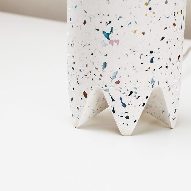 Detail shot of our 'confetti' colored terrazzo Bob Lamp. These lamps are cast in hydrostone with our own custom blend of recycled glass aggregate. ⠀ ⠀ Half gold mirrored top 40W/120V bulb included. B&W striped fabric cord with switch included. ⠀ ⠀ Please contact us via email for wholesale orders and pricing. © 2019, Talbot & Yoon, LLC U.S.A., All rights reserved.⠀ ⠀ #talbotandyoon #boblamp #tablelamp #terrazzo #concrete #design #interiordesign #madeinbrooklyn #hydrostone #lamp #rainbow #detail #recycledglass #recycled #confetti #lighting #lightingdesign #lightingdesignnyc #madeinbrooklyn