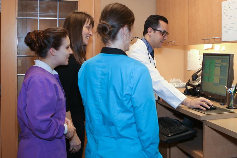 Seattle Dental Studio staff discussing treatment options