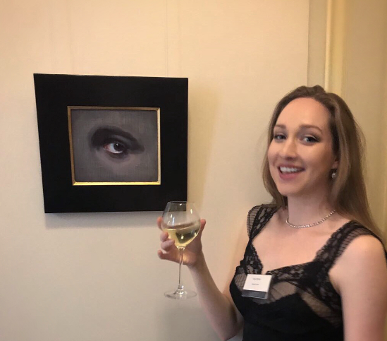 """Sofia Welch with her exquisite painting, """"The Eye of Providence""""."""