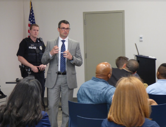 Detective Mark Russin speaking to community members about the implementation of police body cameras in Syracuse.
