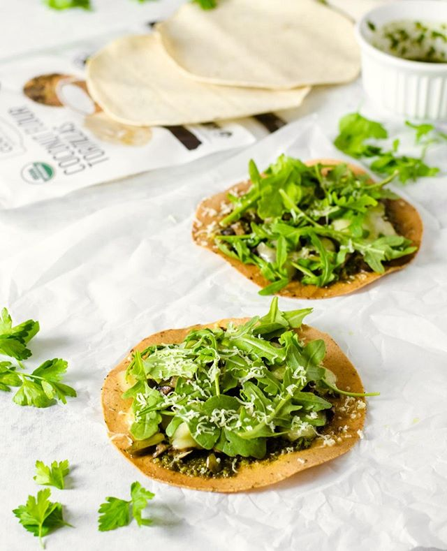 Ready to go coco-nuts?🥥 You'll love this recipe for Mushroom and Leek Tostadas using our coconut flour tortillas! Here's how to make them:⁠ ⁠ Gremolata Sauce:⁠ 1 cup fresh Italian parsley⁠ 1 cloves garlic⁠ 1 tsp lemon zest⁠ 3-4 Tbsp olive oil⁠ 1-2 Tbsp fresh lemon juice⁠ 2 tsp dried oregano⁠ 1/2 tsp kosher salt⁠ 1/4 tsp black pepper⁠ ⁠ Tostadas:⁠ 8 oz chopped mushrooms⁠ 1 large leek, cleaned and chopped⁠ Avocado or coconut oil⁠ Pinch of salt and pepper⁠ 4 The Real Coconut tortillas in any flavor⁠ Cheese of choice, regular or dairy free⁠ Fresh arugula⁠ ⁠ Instructions:⁠ Make the sauce by placing parsley, garlic, and lemon zest in a food processor and pulse until coarsely chopped. Add the remaining sauce ingredients and pulse until combined but not too smooth. Set aside.⁠ ⁠ Add a little avocado or coconut oil to a skillet with the mushroom, leek, and a pinch of salt and pepper. Sauté over medium heat for 5-10 minutes. Remove from heat and set aside.⁠ ⁠ Brush tortillas with a little avocado or coconut oil on both sides. Bake on a parchment lined baking sheet at 375 F for 4 minutes, flip the tortillas, then bake another 2-4 minutes until just lightly golden and crisp.⁠ Make sure to keep a close eye on them so they don't burn!⁠ ⁠ Remove tortillas from oven, top with gremolata sauce, some mushroom and leek mixture, and cheese. Turn off the oven, and place the tortillas back into the oven for a few minutes just until the cheese melts.⁠ ⁠ Remove, place tostadas on serving platter, and top with fresh arugula.⁠ ⁠ #therealcoconut #glutenfree #grainfree #tostada #tostadas #goodmoodfood #coconutflour #allergyfriendly #glutenfreepizza⁠ #tortillas #huffposttaste⁠ #weeknightmeals