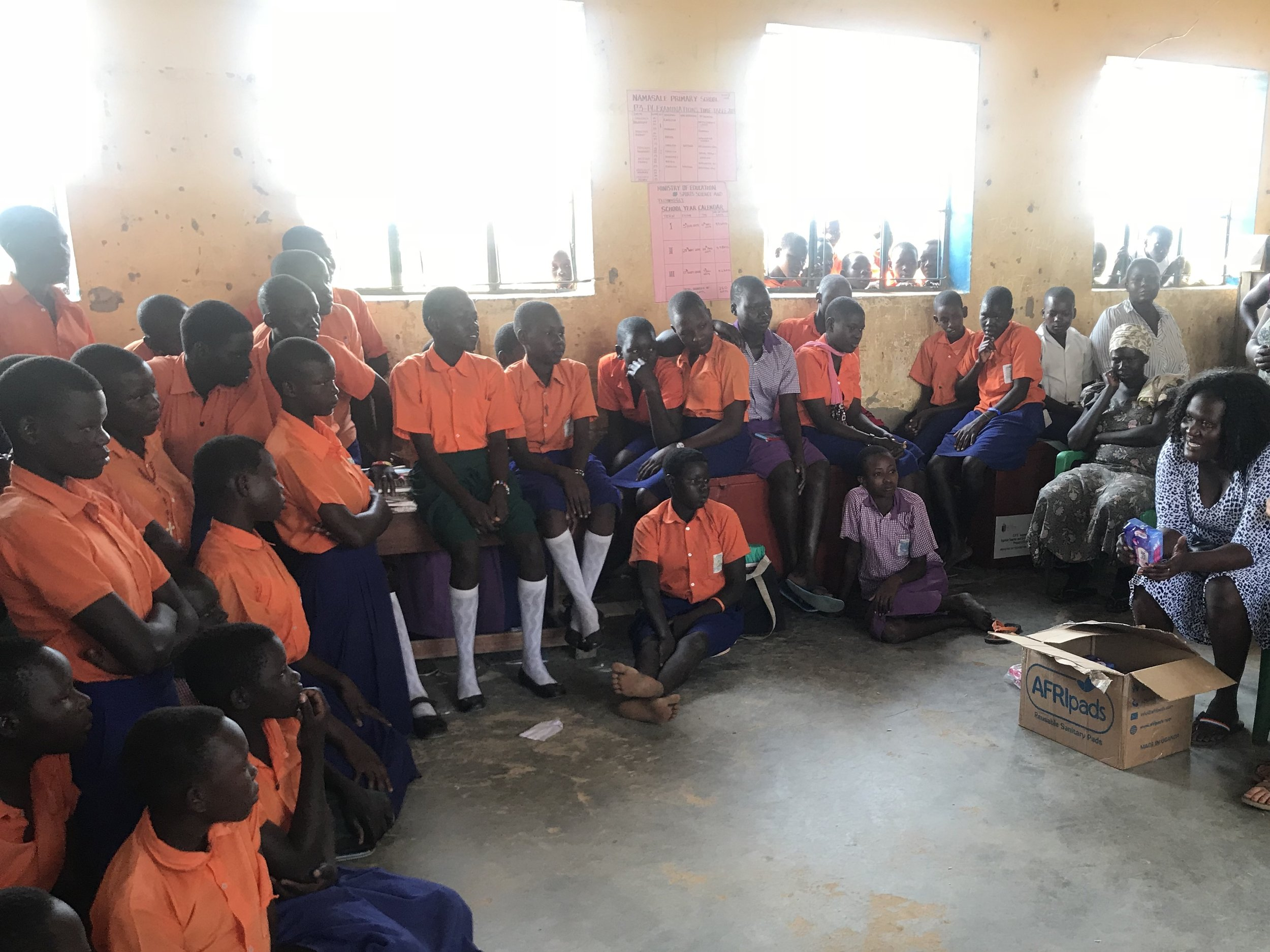 Our Co-Founder & Country Director, Collines, who was born & raised in Namasale, Uganda, sharing her story to the students at one of our partner schools.
