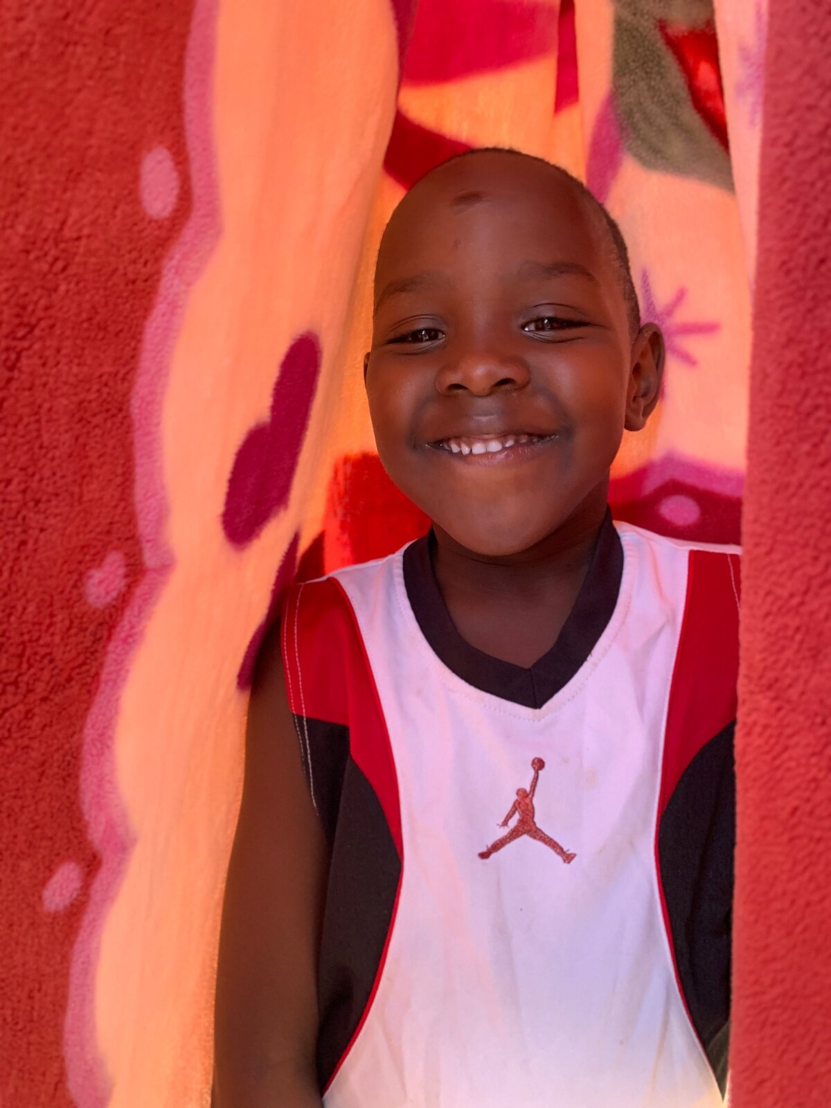 The Ayena's youngest son, Timothy, who is a student at Far Away Friends' primary school, GLP.