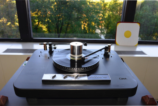 """Gerrard 401 Turntable with Oma plinth (price unknown), with Schroder CB Ebony 11"""" Tone arm ($4,750), Miyajima Labs Madame Stereo cartridge ($5,895), and a Gyrascope 33/45 Strobe/Puck ($475)."""