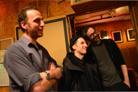 Elan Mehler (L) with mastering engineer Alex Deturk (M) and recording engineer Marc Urselli (R) looking on proudly while the musicians they represent listen on vinyl to their work.